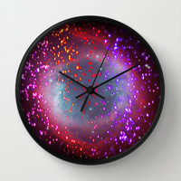 sparks of attraction Wall Clock by Marianna Tankelevich