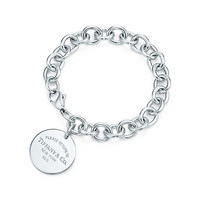 Tiffany & Co. - Return to Tiffany™ round tag charm bracelet in sterling silver.