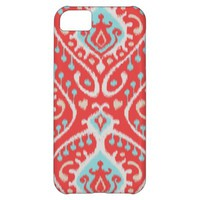 Vibrant ikat pattern in red and turquoise