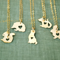 tiny gold animal silhouette necklace