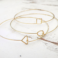 Delicate Gold Geometric Bangles, set of 3 thin hammered bracelets.