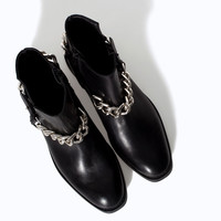 FLAT LEATHER ANKLE BOOT WITH CHAIN DETAIL