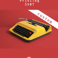 REFURBISHED TO ORDER /// 1980s Privileg 350T Typewriter. Techno typeface. Fully working. Yellow and black. With Case.