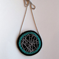 Embroidered pendant necklace with silver dreamcatcher inspired design and teal on black textile jewelry
