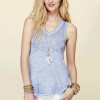 We the Free brings us back to our down-to-earth Tri-Blended Breezy Tank Top by Free People. Featuring super soft and lightweight semi sheer burout tri-blended jersey fabrication, v-neckline, thick shoulder design, slip on style, flare asymmetrical hem. Pai