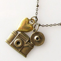 camera necklace and heart by KriyaDesign