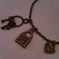 Unlock My Heart Antique Gold Charm Bracelet by BySilverRose