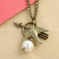 The Hunger Games Necklace with Katniss Bow and Mockingjay by mosnos