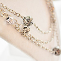 Long multistrand silver chain metal bead necklace