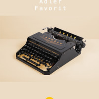 1937 Adler Favorit 1 Typewriter. Restored and fully working. Thrust-action. German portable. Black and golden. With Case.