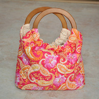 quilted paisley pouch bag - bright pink and orange, floral and paisley, with off-white and orange lining, with round wooden handles