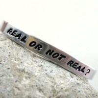 Real or Not Real? - The Hunger Games Bracelet, Hand Stamped, Customizable
