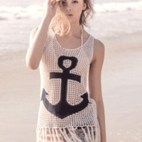 Charm them all with your gorgeous style in this Anchor & Fringe Knit Tank Top! This relax fit nautical tank top features semi-sheer knit with navy color anchor pattern at front, round neckline, and finished with fringe detailing at bottom hem. Pair black b