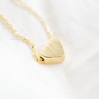 This tiny cute heart necklace features a small heart that floats freely on a cute chain. Such a feminine