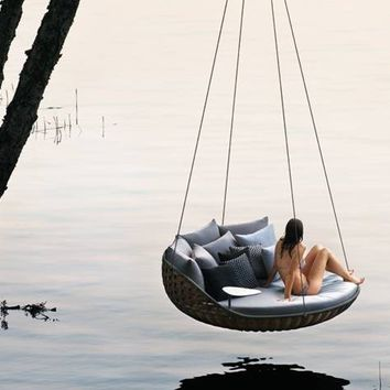 Wicker garden suspended chair Swingrest Collection by Dedon | design Daniel Pouzet