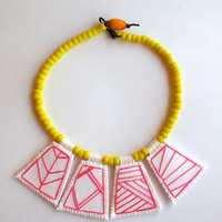 Geometric necklace embroidered hot pink pendants with bright yellow Native American trade beads with Ethiopian amber toggle