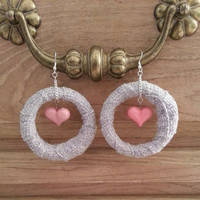 Grey fabric hoops with pink hearts inside earrings