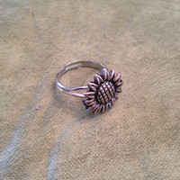 Silver sunflower adjustable ring.