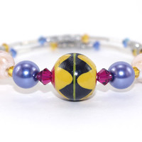 Yellow black African Ashanti glass bead memory wire bracelet, Red yellow blue Swarovski crystal, Silver plated braclet,  Memory wrap bangle