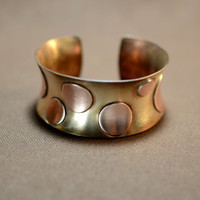 Copper polka dots on bronze anticlastic contemporary bracelet