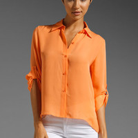 ALICE + OLIVIA Cropped Button Down Blouse in Neon Orange at Revolve Clothing - Free Shipping!