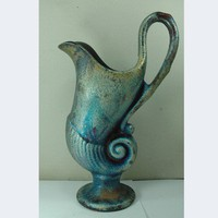 Raku Fired Shell Pitcher | madstone - Ceramics & Pottery on ArtFire