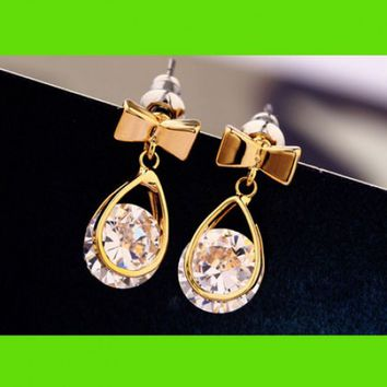 Golden Trim Diamond And Bow Earrings
