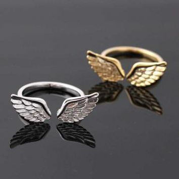 silver angel wing ring adjustable by bythecoco on Zibbet