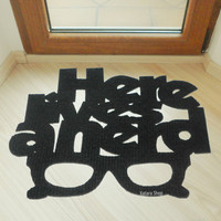 """Door mat """"Here lives a nerd"""" and a glasses. Funny welcome mat"""