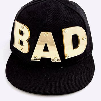 B2 – GOLD ACRYLIC BAD SNAPBACK