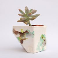 Brown, green and teal geometric ceramic planter