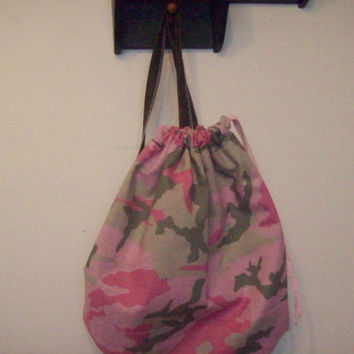 fun stylish, pink and green camoflauge backpack, great for ballgames, amusement parks, dance bags, toy bags and more