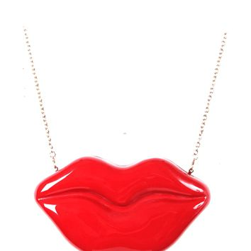 """Featuring an oversized lip design, glossy enamel, snap closure, and finished with a curb link chain strap with a 21"""" drop."""
