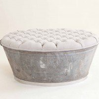 Amazing DIY Idea: Repurposed tub to an ottoman.