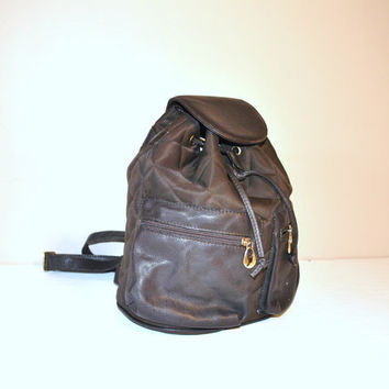 large padded brown leather backpack