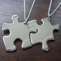 Two Silver Puzzle Piece Pendants by GorjessJewellery on Etsy