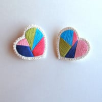 Embroidered heart brooch pair with geometric shapes blues pinks and light green