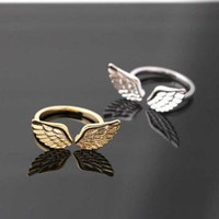 gold angel wing ring adjustable  by bythecoco on Zibbet