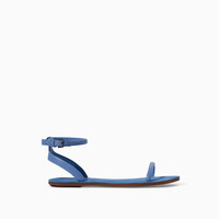 FLAT SANDAL WITH ANKLE STRAP