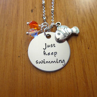"Disney's ""Finding Nemo"" Inspired Necklace. Dory ""Just Keep Swimming"". Silver colored, Swarovski crystals, for women or girls"