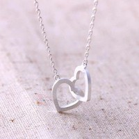crossed heart never apart necklace in silver by bythecoco