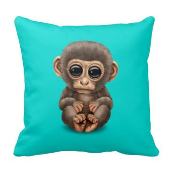 Cute and Curious Baby Monkey on Blue