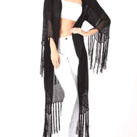 Featuring semi-sheer knit kimono with floral & goat print on back, longline construction, open front, quarter-length sleeves with fringe detailing, and finished with fringe on bottom hem. Pair with high waist jeans, crop top and ankle booties.