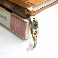 vintage gold ribbon bookmark with Believe charm
