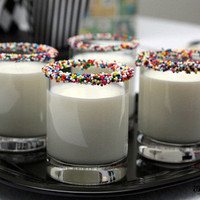Decorated glass of milk in Recipes for babies, children and adults parties, such as birthdays, celebrations, anniversaries or dinners