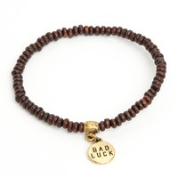 BAD LUCK CHARM WOOD BRACELET