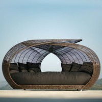 Neoteric Modern Spartan Wicker Outdoor Daybed at HomeInfatuation.com.