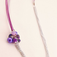 Ribbon and multi chain necklace in purple tones with bead cluster