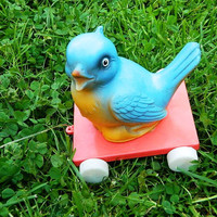 Adorable rubber bird on wheels (Made in DDR) - pull toy