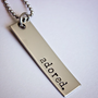 Adored hand stamped stainless steel tag necklace, can be personalized by StampedMemoriesbyMel